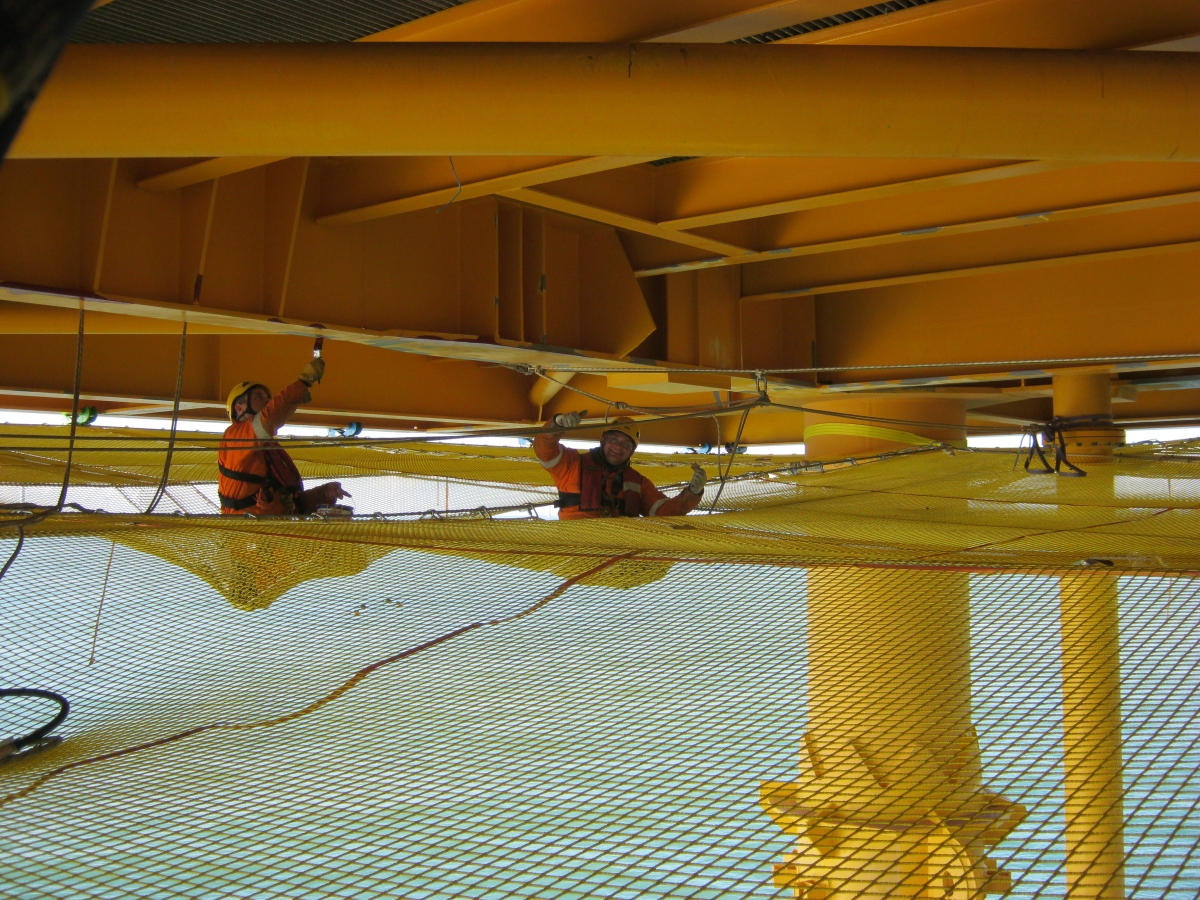 Men Working on Rope Access Netting Oil Rig Platform 3.jpg